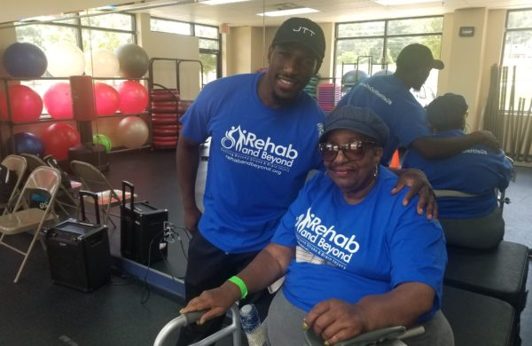 Rehab and Beyond Rehabilitative Trainer and Stroke Survivor Post for Picture During Therapy